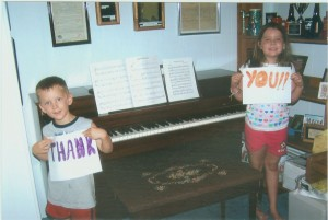 Two lucky kids with a free piano from the BCPAI